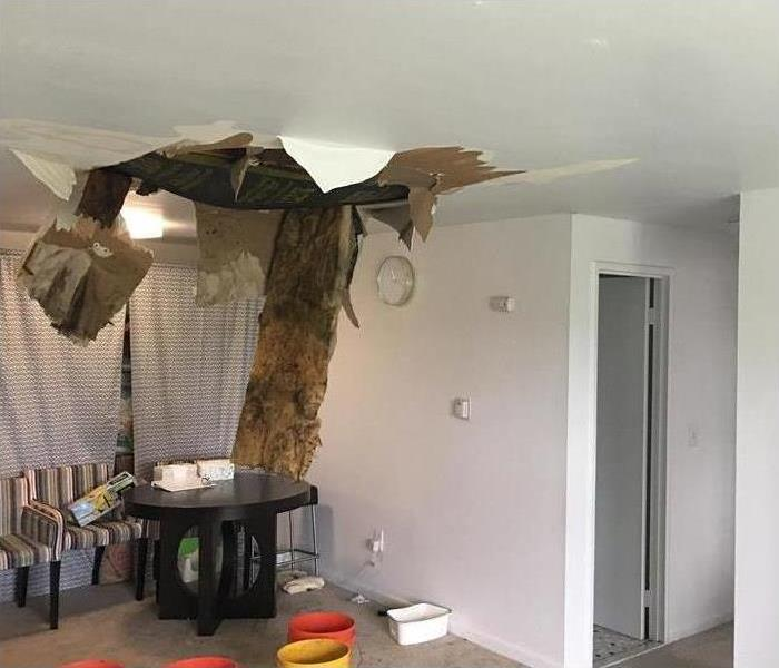 Hole on ceiling caused by a storm