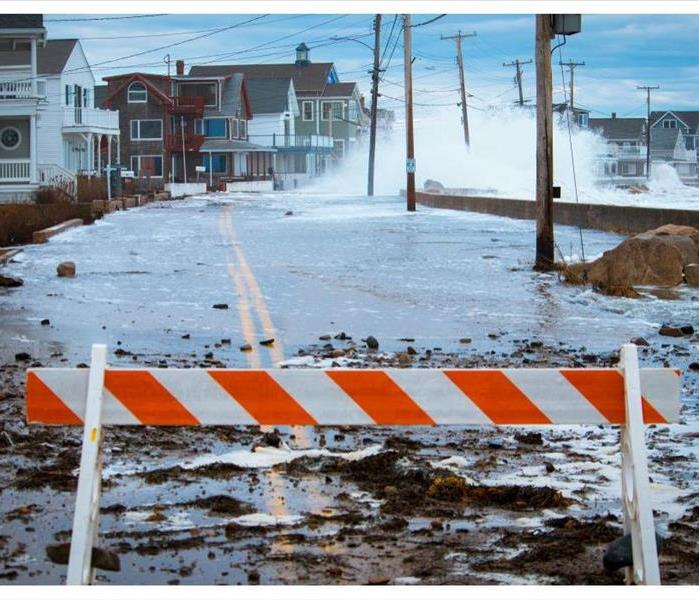 Storm waves crash over the seawall causing massive flooding, power outages, road closures, and erosion damage along the Maine
